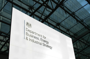 A sign saying Department for Business, Energy and Industrial Strategy with a government logo.