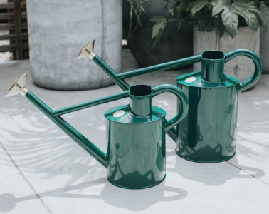Two dark green Haws watering cans
