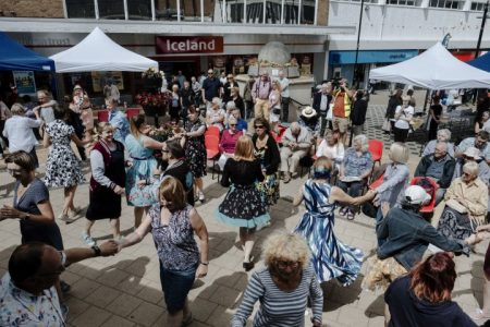 People dancing in the street outside Iceland shop