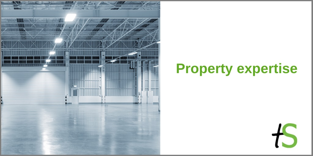 Property expertise banner with Think Sandwell logo and photo of shiny empty warehouse
