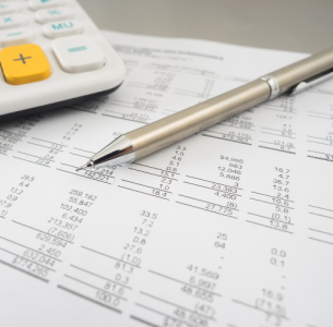 Balance sheet with silver propelling pencil and a calculator