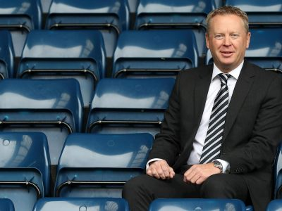 The chief executive of West Bromwich Albion, Mark Jenkins, sitting in the stands