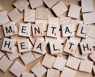 Scrabble tiles spelling out 'mental health'
